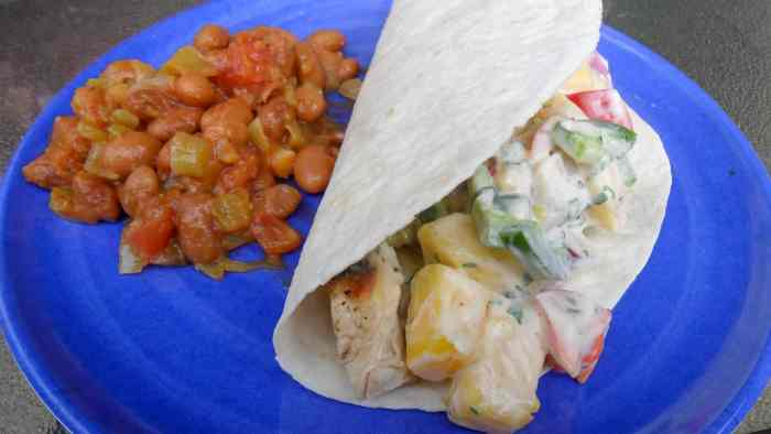 Grilled chicken tacos with mango cilantro ranch dressing is a fresh take on a mexican tex-mex classic dish.