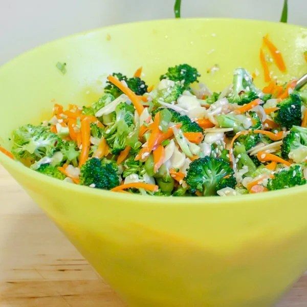 A fresh, crisp salad recipe with broccoli, carrots and green onions. The Asian dressing is made up of sesame oil, soy sauce, rice vinegar, honey, ginger, garlic and dried chillies.