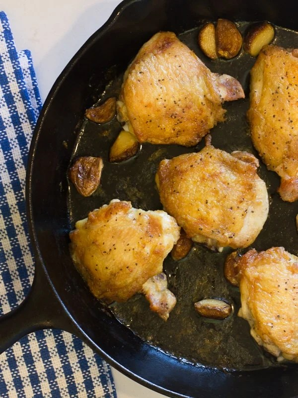 The ultimate recipe for cooking chicken thighs in a cast iron skillet. Start on the stovetop and finish in the oven.