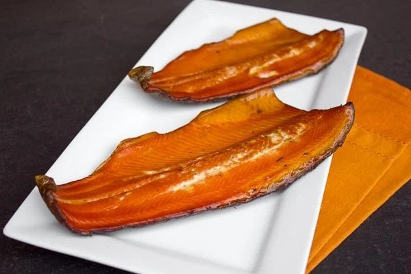Wood smoked rainbow trout that has been marinated in a sweet wet brine. Simple instructions and recipe for how to smoke a rainbow trout.