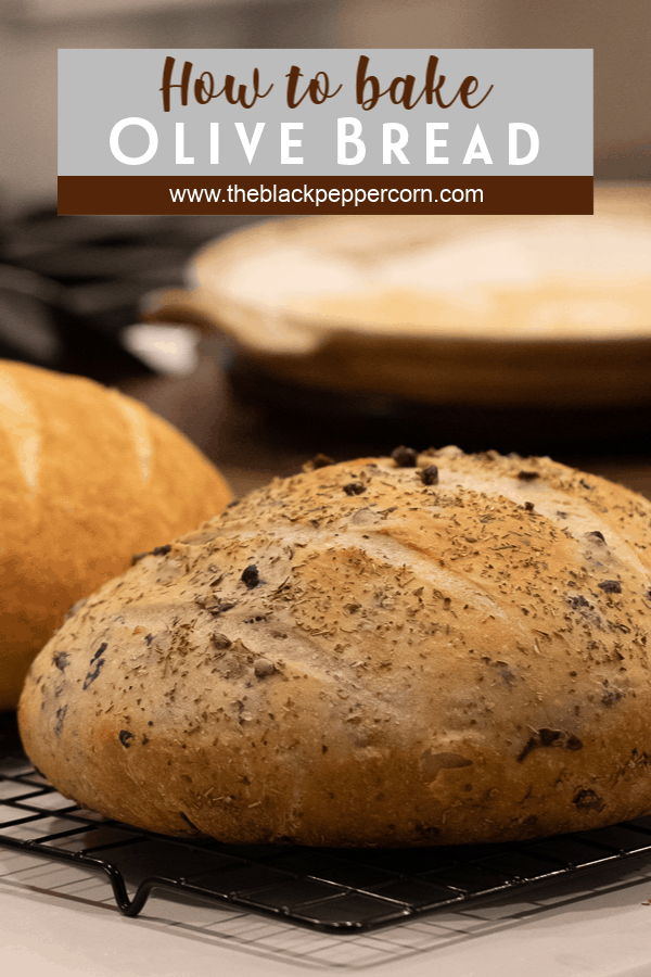 Easy to make rustic olive bread with oregano. Crusty round bread loaf with kalamata olives. How to bake recipe for a delicious fresh loaf of bread.