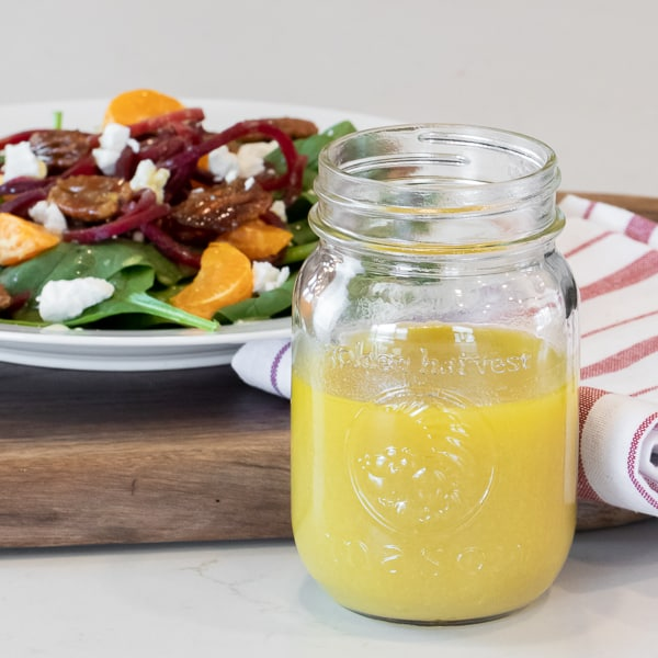 Homemade salad dressing recipe is made with dijon mustard, honey and vinegar. This sweet vinaigrette is perfect for spinach or salad of greens.