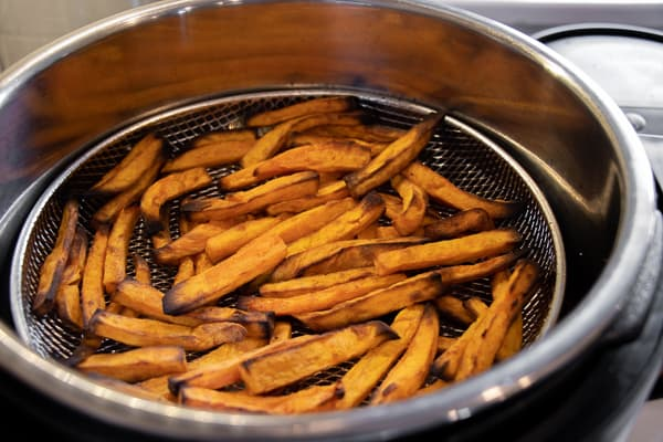Air Fryer Sweet Potato Fries Recipe - Easy instructions for how to make sweet potato french fries in an air fryer. Crispy and tastes just like deep fried but this recipe uses very little oil. Sweet potatoes make the perfect fries.