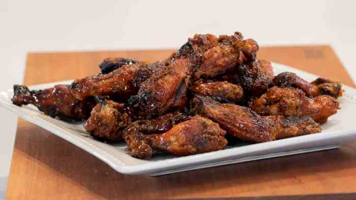 Sweet Thai Chili Smoked Chicken Wings Recipe - Simple instructions for how to smoke chicken wings with a delicious rub and a sweet and sticky Thai chili glaze.