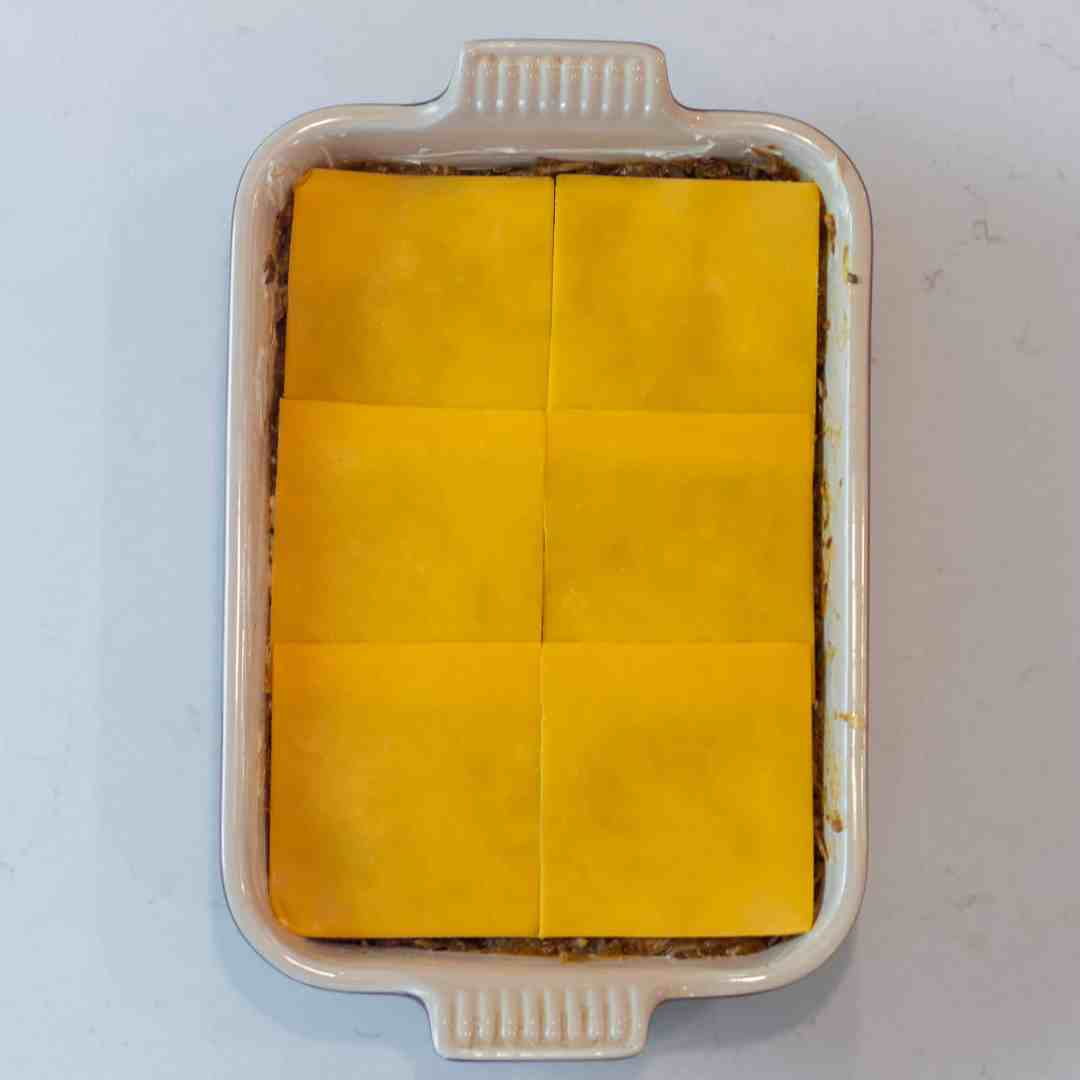 Lay the cheese slices down.