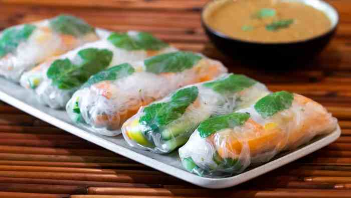 Cold fresh salad rolls are a popular appetizer for Vietnamese and Thai restaurants. Vietnamese spring rolls made with rice paper, mango, shrimp and more.