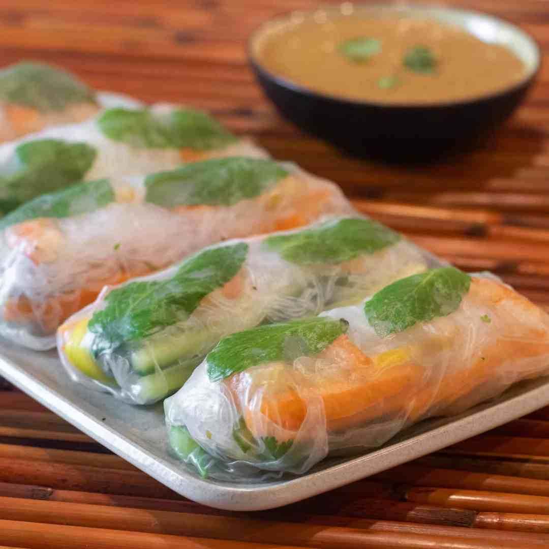 Serve the cold spring rolls with peanut sauce.