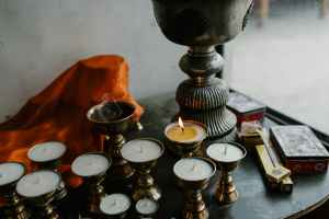 traditional tibetan candle holders placed on table