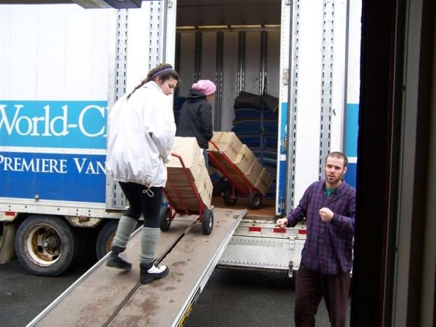Katimavik volunteers unload boxes of books from Dal. U.