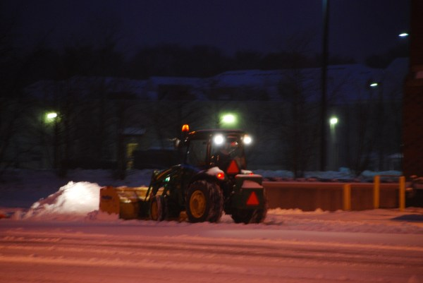 Carl' Lawn Care & Landscaping - Tractor Pushing Snow
