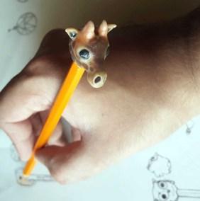 hand closeup Giraffe Pencil Head designed by BMK