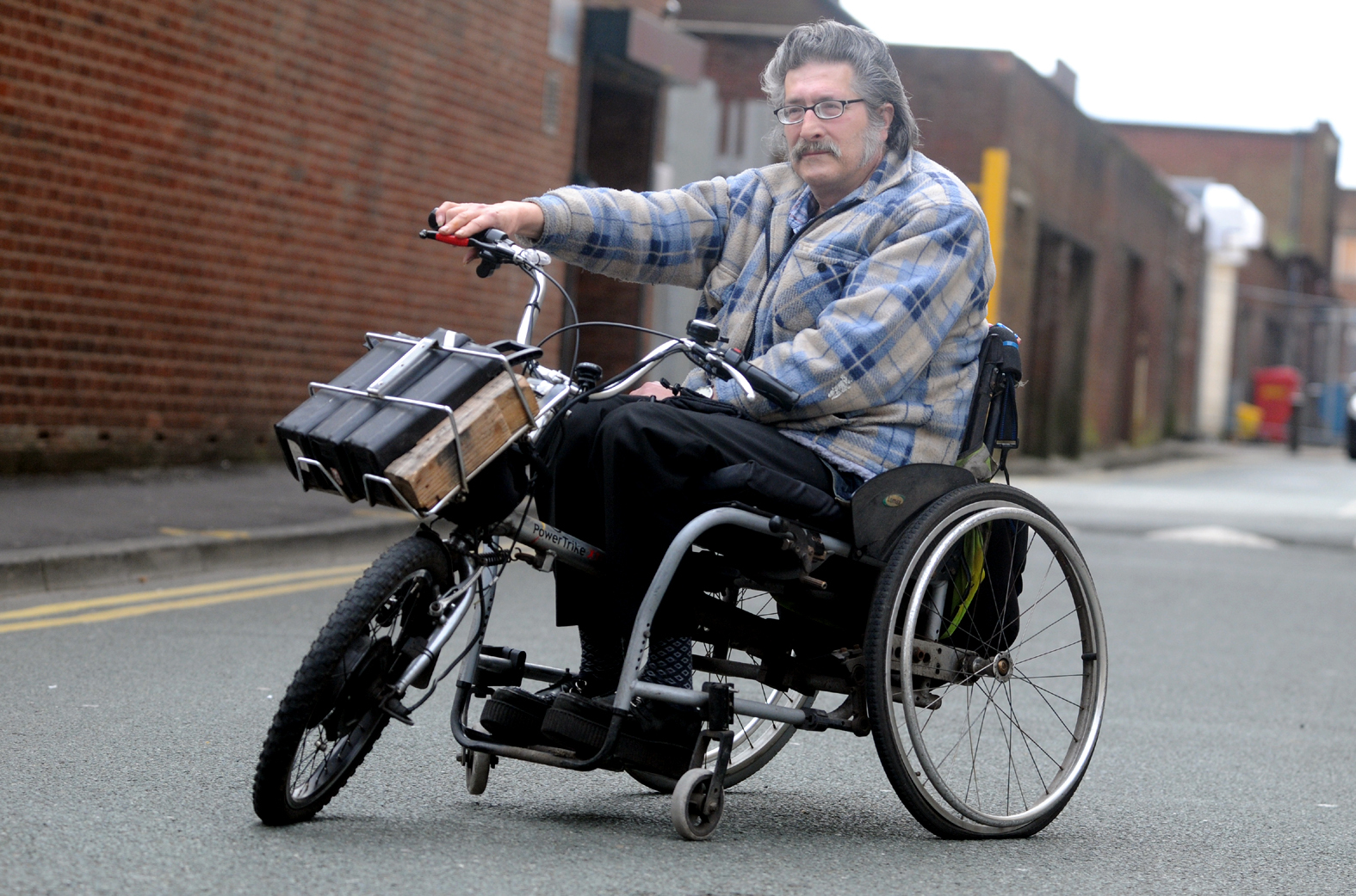 wheelchair man hsl chair accessories disabled caught in limbo after police threaten to seize ronny druckmann on his trike