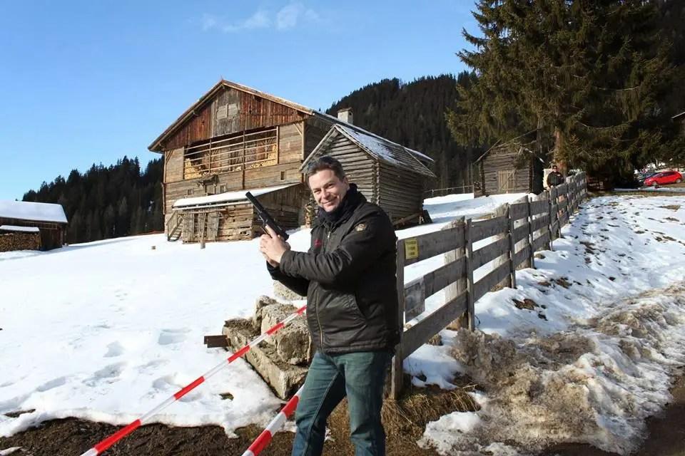 "James Bond Club Switzerland President Markus Martmann posing as 007 in front of the Obertilliach ""Bond House"" / Photo Copyright: Markus Hartmann"