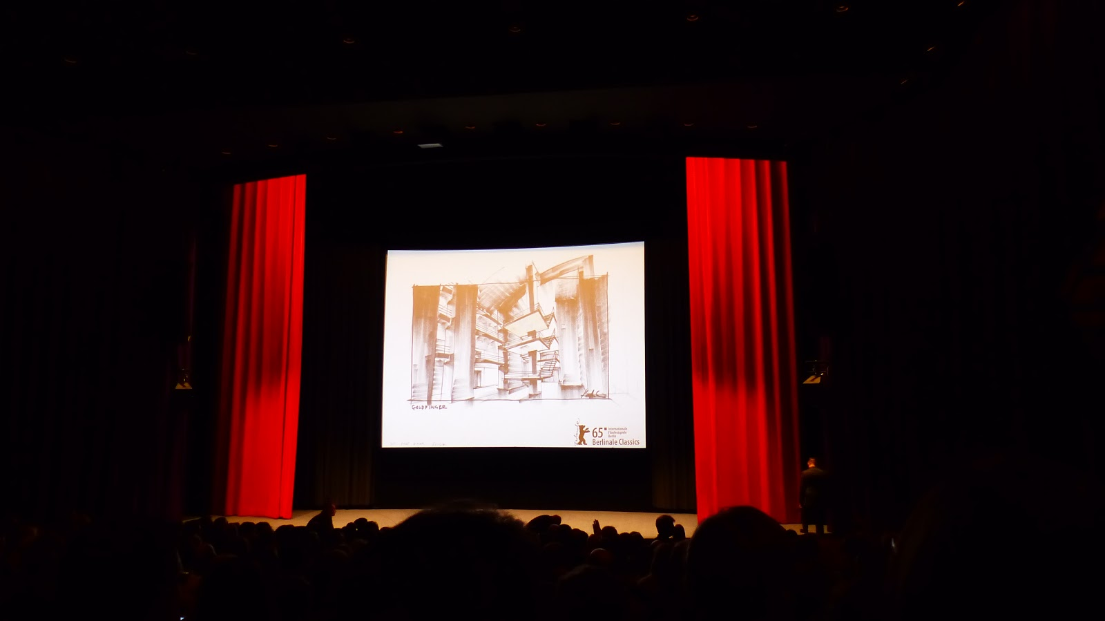 The stage and screen of Haus der Festspiele at the GOLDFINGER 4K Premiere / Photo: Benjamin Lind