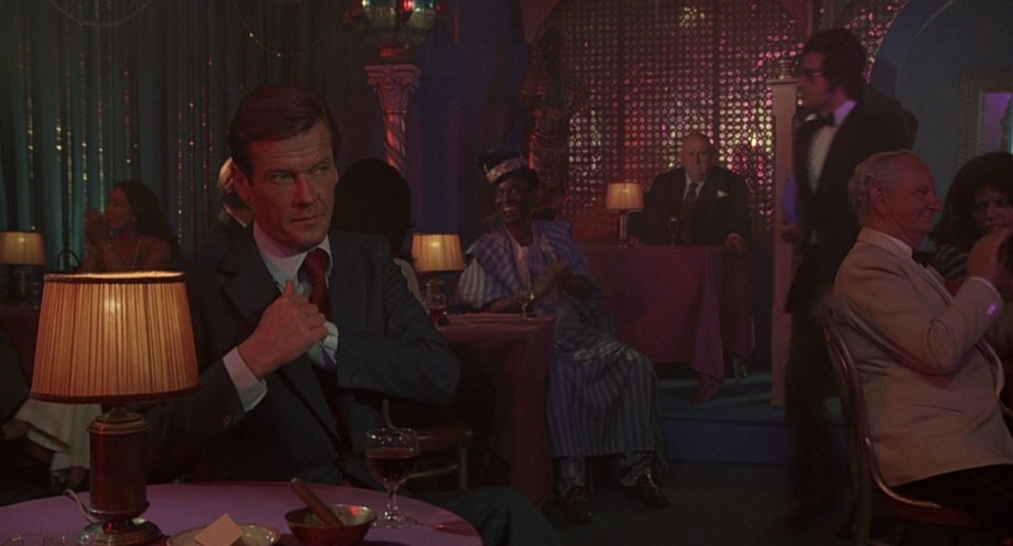 Another one next to one of the henchmen sitting at a private table behind Bond