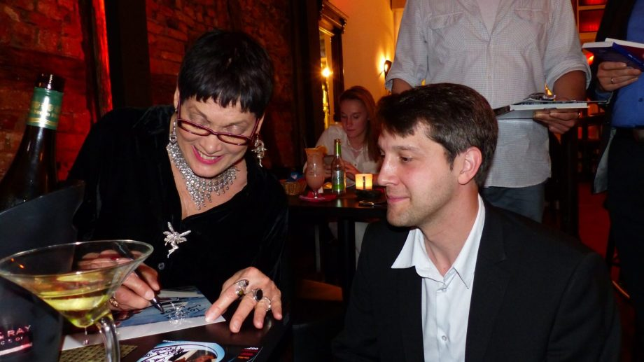 Actress Martine Beswick signing for Danny Morgenstern
