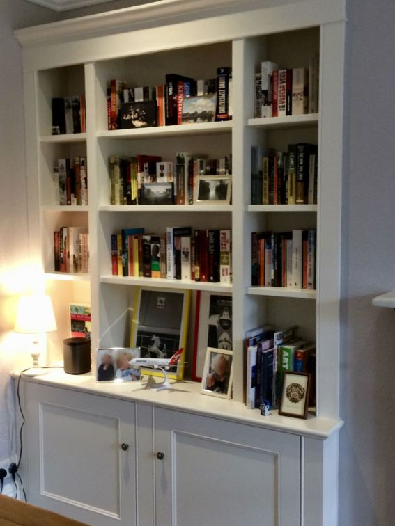 Custom Made Bookcase with shellving to upper sections and cupboards below