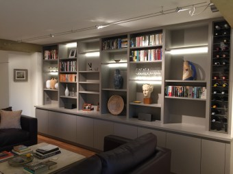 Custom made wall to wall bank of shelving with built in wine racking