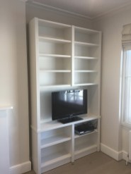 Stand alone media shelving unit