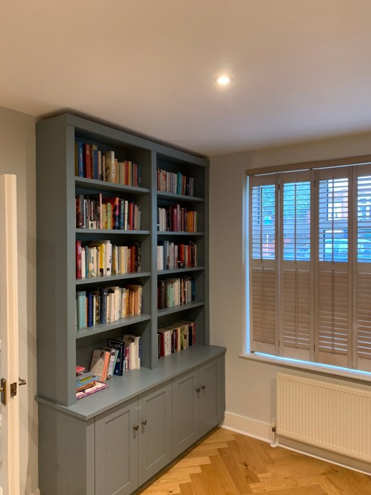 Useful bookcase shelving with cupboard storage below