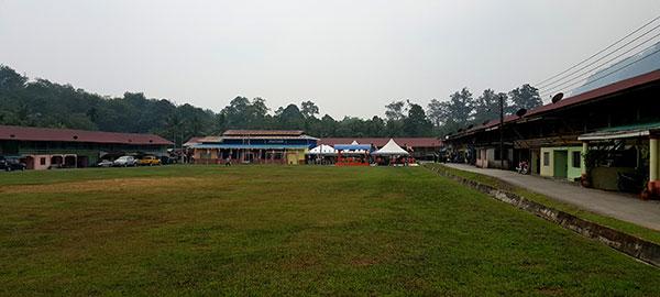 An expasive front view of the Kampung Darul Islam Belimbing longhouse.
