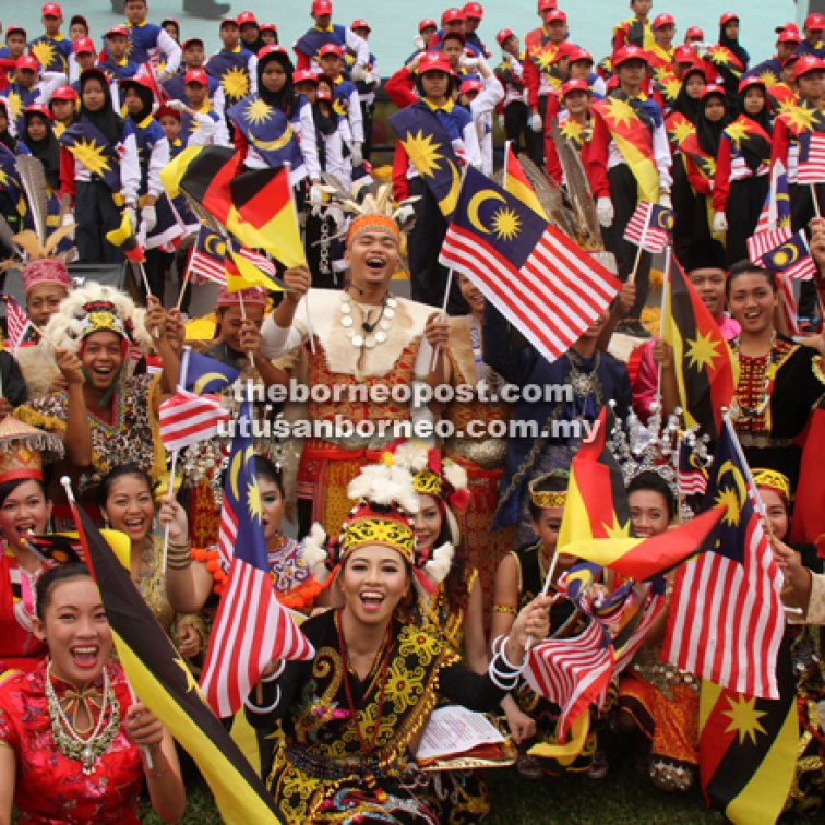 All smiles from the participants of the celebration, showcasing the vibrant culture in Sarawak.