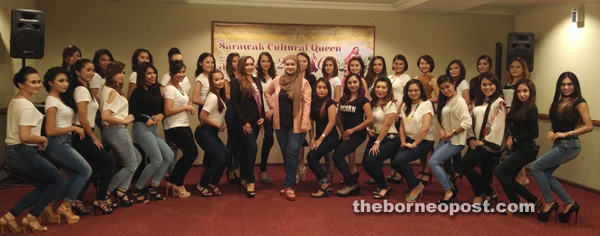 Sharifah (standing centre) flanked by winner of Sarawak Beauty Queen 1/2014 Cammielye Oliver Rega on her right in a group photo with the semi-finalists.