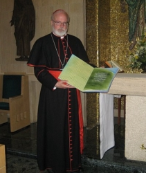 Cardinal Seán P. O'Malley holds a book containing over 1,000 names of known Boston victims of clergy sexual abuse that was presented to Pope Benedict XVI at a meeting between the Holy Father and five survivors of sexual abuse by clergy April 17. Pilot photo/Courtesy Barbara Thorp