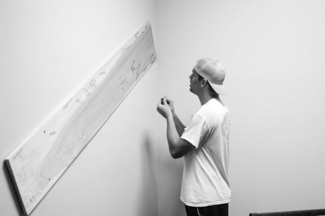 Max from Wilmington's top radio station z107.5 signing the escapee board at The Breakout Room in Downtown Wilmington NC