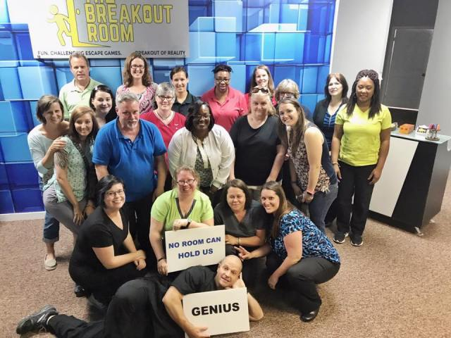 Employees enjoy corporate team building at the breakout room escape room in wilmington north carolina