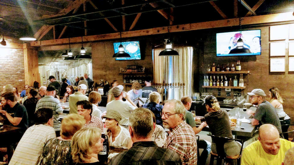 Silver Moon Brewing remodel: crowd and bar