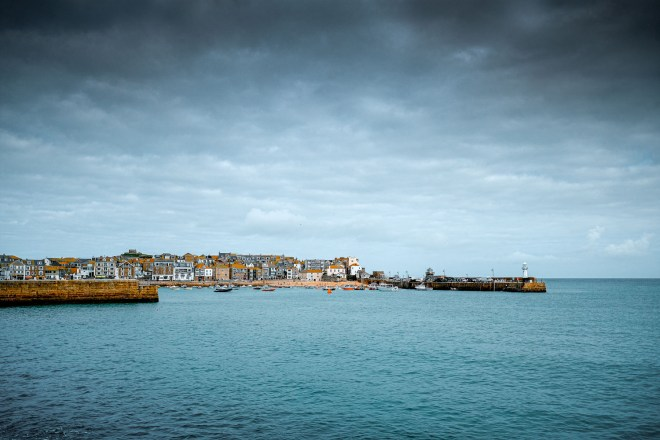 St Ives Harbour with a cloudy sky.