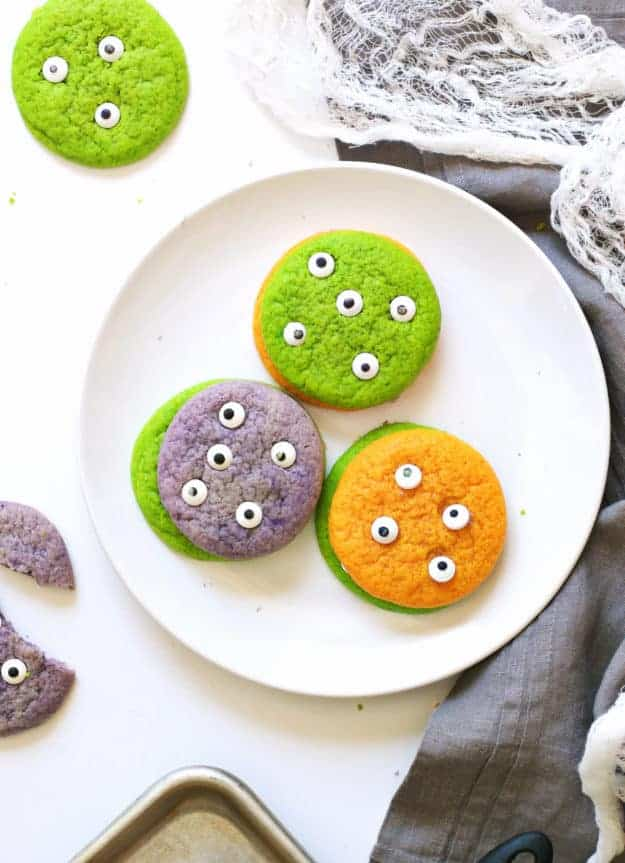 Make these boo-tiful Halloween Sugar Cookie Monsters for a party, or simply for a fun holiday baking activity with the kids. Simple to make and fun to eat, these cookies are a great addition to your Halloween fun! || The Butter Half #halloweensugarcookie #monstersugarcookies #halloweencookies #thebutterhalf