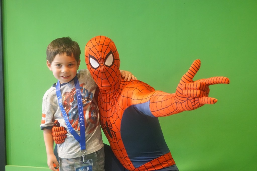 My son, hanging out with Spiderman, at Islands of Adventure.