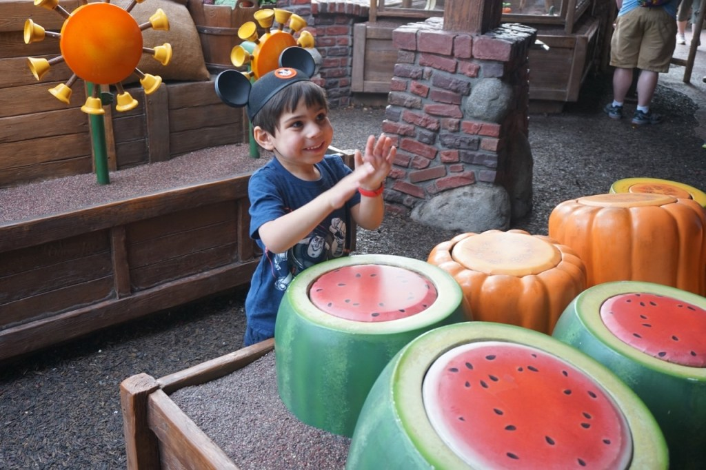 Disneyland vs. Disney World: My son loves the interactive queue at The Many Adventures of Winnie the Pooh in the Magic Kingdom.