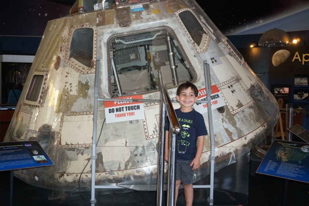 Standing in front of the Apollo 9 Command Module at the San Diego Air & Space Museum.