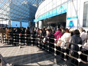 Outside, everyone lines up outside the Tokyo Dome waiting patiently for the doors to open.