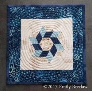 Sea Star mug rug pattern, blue and cream hexagons, free pattern by Emily Breclaw