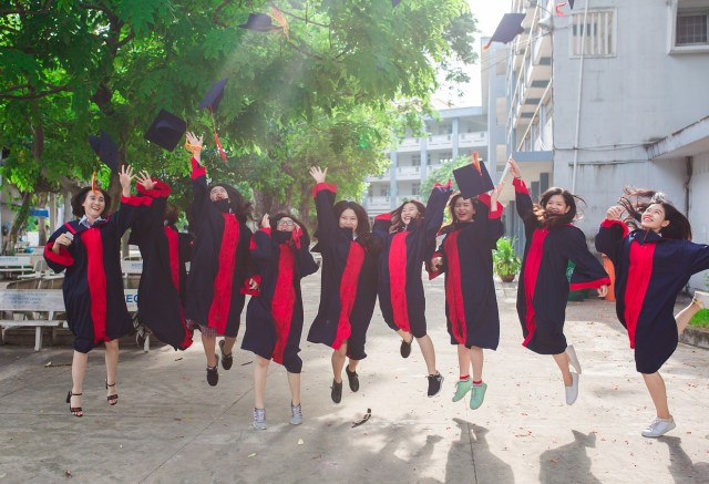 Asian students graduating and celebrating