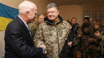 McCain shakes hands with second coup president Poroshenko