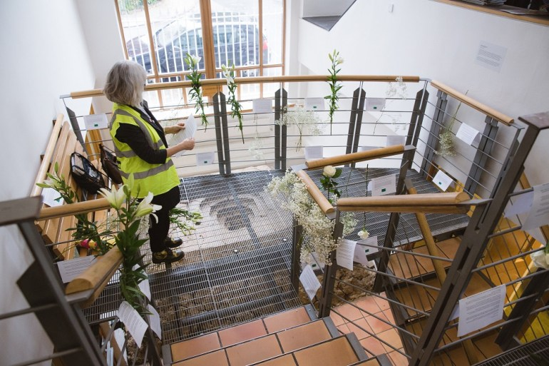 Flowers on a Greenpeace stairwell