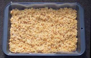a pan of cannabis-infused rice krispy edibles. the brown rice crispies are in a square shape.
