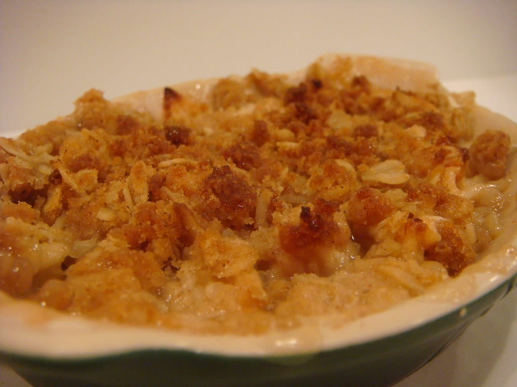 Weed infused apple crisp. the golden crust shows on the outside with the juicy apples underneath.