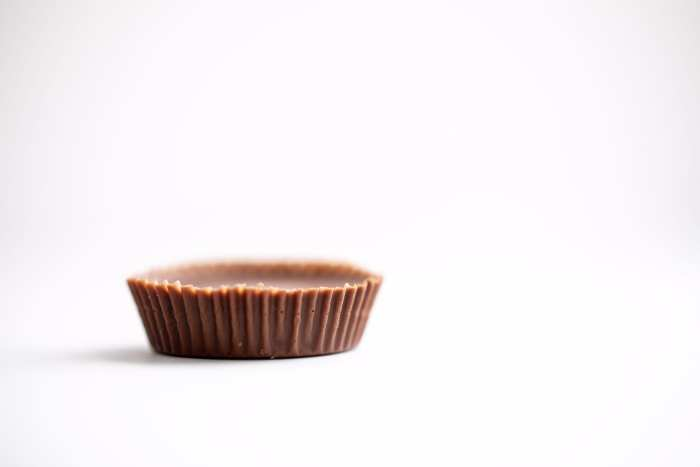Peanut butter cup shot on a white background macro