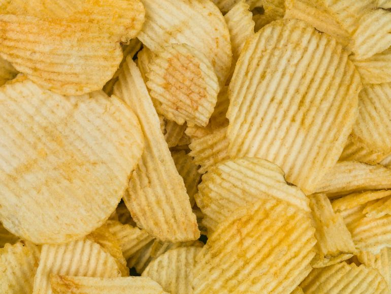 macro of weed potato chips piled on top of each other
