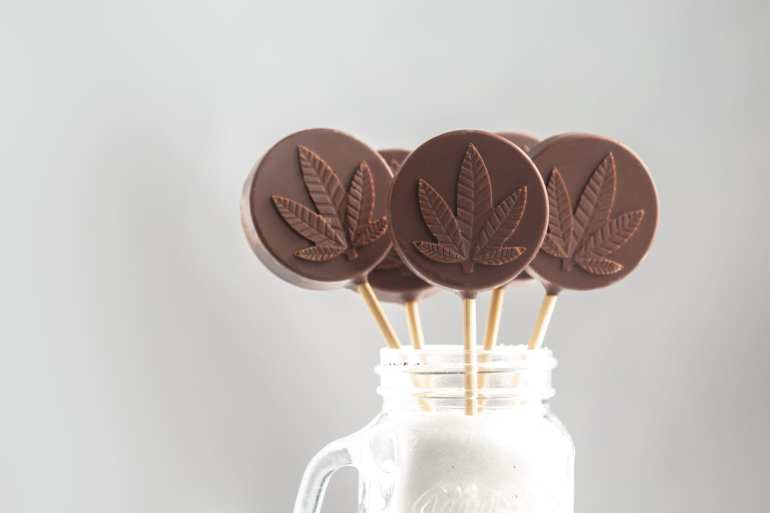 4 weed edible lollipops in a milkshake that is infused with cannabis.