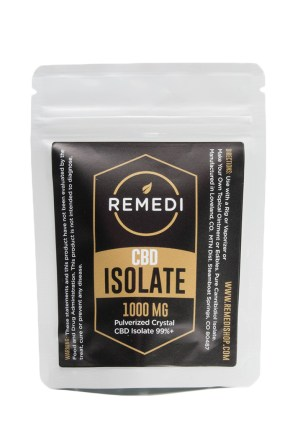 CBD isolate used to make CBD butter. The plastic sealed bag of isolate has the brand remedi written on the front.