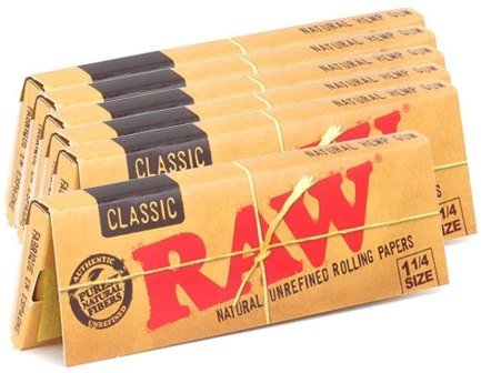 RAW natural rolling papers sold on Amazon. The picture includes 5 packs of rolling papers. One of the best stoner gifts ideas.