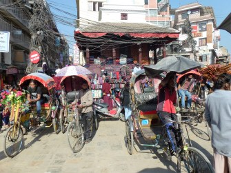 Rickshaws are seen at a busy marketplace in Nepal. Photo: Courtesy of Tom Blake