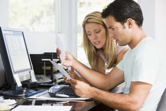 A couple discussing car finance, like a personal contract purchase (PCP)